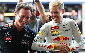 Team principal Christian Horner with Vettel. Together they won 4 straight championships.